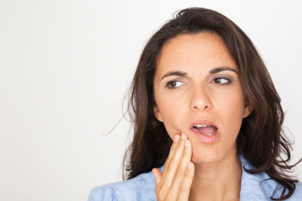 woman with toothache contemplating tooth extraction in Tallahassee, FL